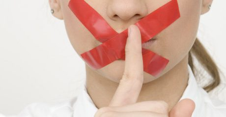 Woman with Tape Over Mouth